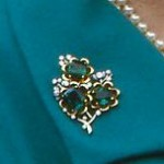 Gold four-leaf shamrock pin, emeralds and diamonds by Sir Frederick and Lady Milner